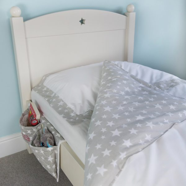 This children's bedside pocket organiser in our exclusive grey star fabric is just so useful. Ideal for all beds, particularly children's cabin beds and bunk beds where a bedside table can be tricky! Great to keep things within easy reach whilst in bed such as books, a water bottle, cuddly toys or a torch.